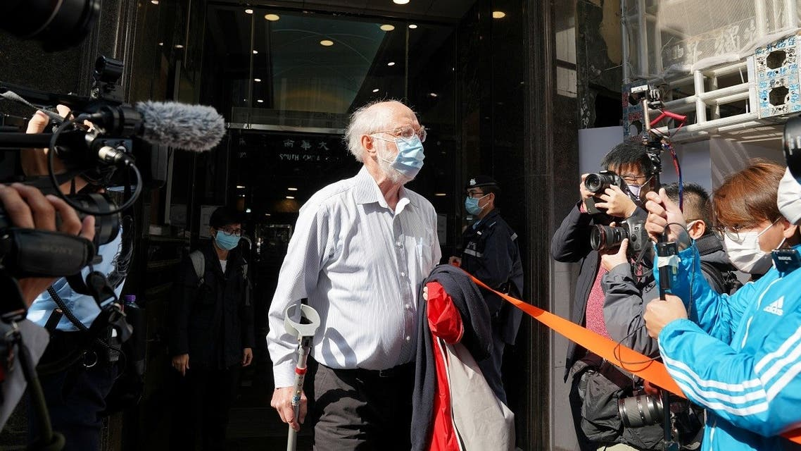 American lawyer John Clancey walks out of a building as he is taken away by police officers in Hong Kong, China, on January 6, 2021. (Reuters)