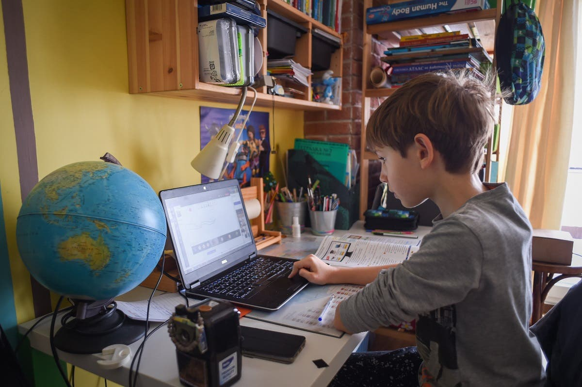 Kamen, 9, attends an online class at his home on November 30, 2020 in Sofia, Bulgaria, as schools close amidst lockdown restrictions to curb the spread of the new coronavirus pandemic. (Nikolay Doychinov/AFP)