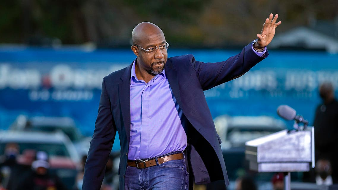 Democratic US Senate candidate Rev. Raphael Warnock waves to supporters during a drive-in rally. (AP)