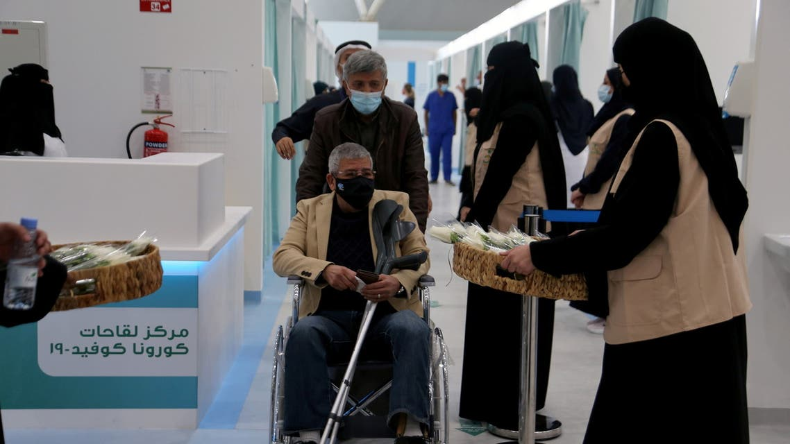 A man in a wheelchair leaving after he received dose of a coronavirus disease (COVID-19) vaccine, in Riyadh, Saudi Arabia December 17, 2020. (Reuters)