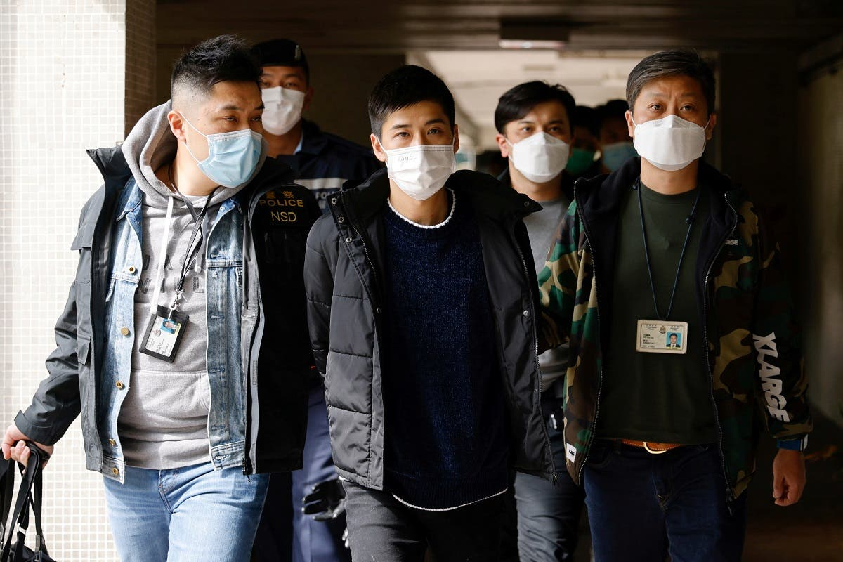 Pro-democracy activist Lester Shum is taken away by police officers after over 50 Hong Kong activists arrested under security law as crackdown intensifies, in Hong Kong, China, on January 6, 2021. (Reuters)