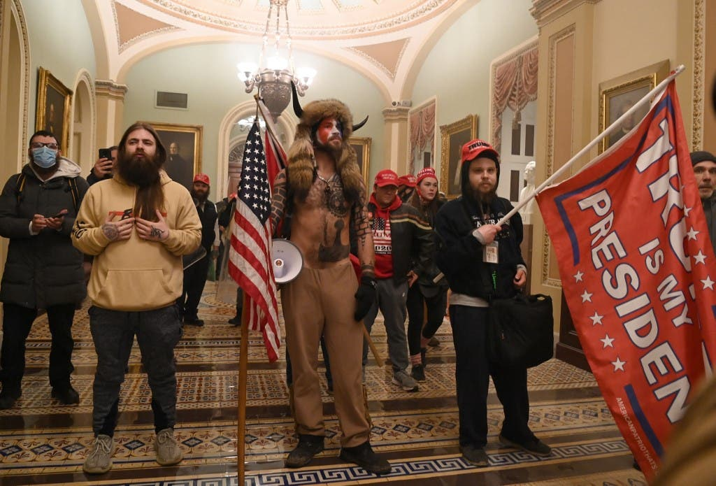 Supporters of US President Donald Trump including Jacob Chansley (center) enter the US Capitol on January 6, 2021, in Washington, DC. Demonstrators breeched security and entered the Capitol. (AFP)