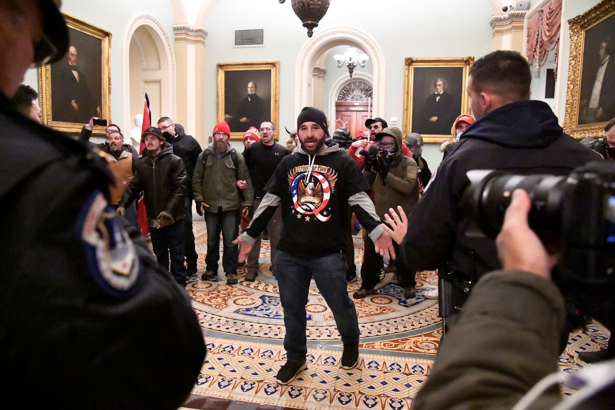A supporter of President Donald Trump confronts police as Trump supporters demonstrate on the second floor of the US Capitol near the entrance to the Senate after breaching security defenses, in Washington. (Reuters)