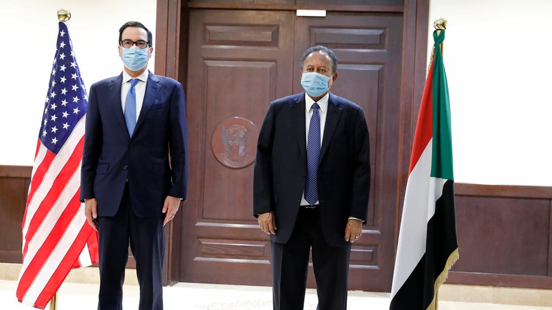 Sudanese Prime Minister Abdullah Hamdok, right, welcomes US Treasury Secretary Steven Mnuchin to the Cabinet Building, in Khartoum, Sudan, Wednesday, Jan. 6, 2021. (AP)
