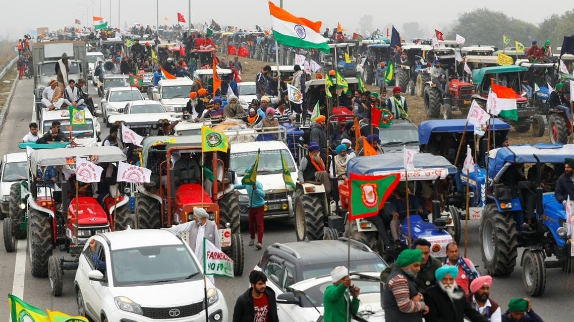 Farmers participate in a tractor rally to protest against the newly passed farm bills, on a highway on the outskirts of New Delhi, India, on January 7, 2021. (Reuters)