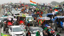 In show of strength, farmers block expressway near Indian capital to protest new laws