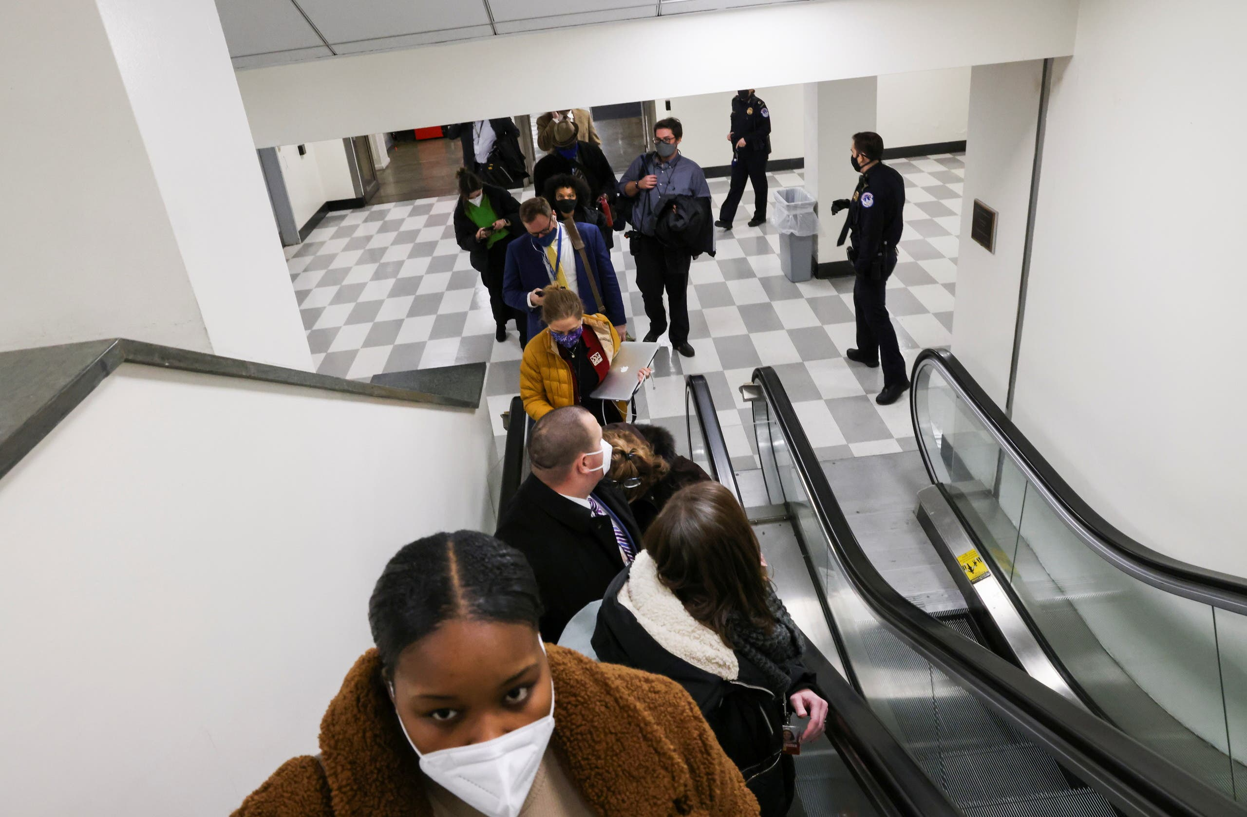 US Capitol Police evacuate journalists and House press staff members from the Capitol to a connected office building, in Washington, US, January 6, 2021. (Reuters)