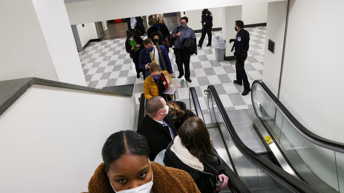 U.S. Capitol Police evacuate journalists and House press staff members from the Capitol to a connected office building, in Washington, U.S., January 6, 2021. REUTERS/Jonathan Ernst