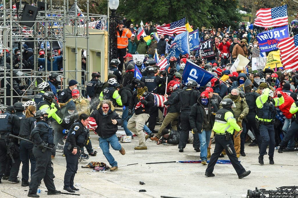 Trump supporters clash with police and security forces as they storm the US Capitol in Washington, DC on January 6, 2021. (AFP)