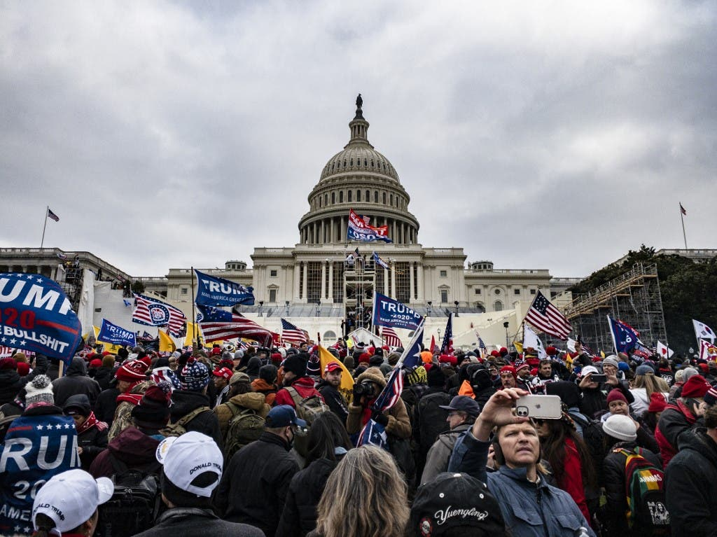 Pro-Trump supporters storm the U.S. Capitol following a rally with President Donald Trump on January 6, 2021 in Washington, DC. (AFP)