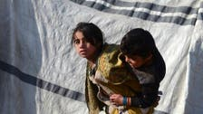 Thousands of Afghan families flee fighting in Taliban bastion of Kandahar
