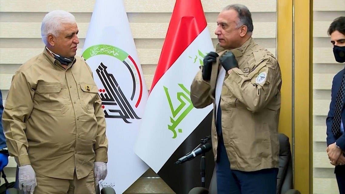 Iraq's Prime Minister Mustafa Kadhemi wears the uniform of the Hashed al-Shaabi during a meeting with Faleh Fayyadh, (File photo: AFP)