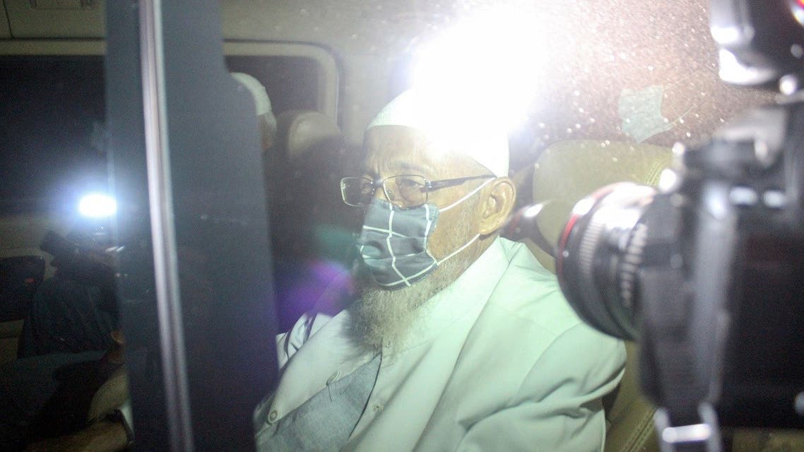 Abu Bakar Bashir, the radical Muslim cleric and alleged mastermind of the 2002 Bali bombings, is seen inside a car as he is released from Gunung Sindur prison in Bogor, West Java province, Indonesia, on January 8, 2021. (Reuters)