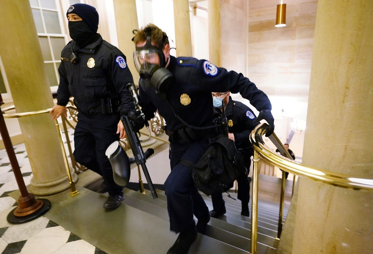 US Capitol police officers take positions as protestors enter the Capitol building during a joint session of Congress to certify the 2020 election results on Capitol Hill in Washington, US, on January 6, 2021. (Reuters)