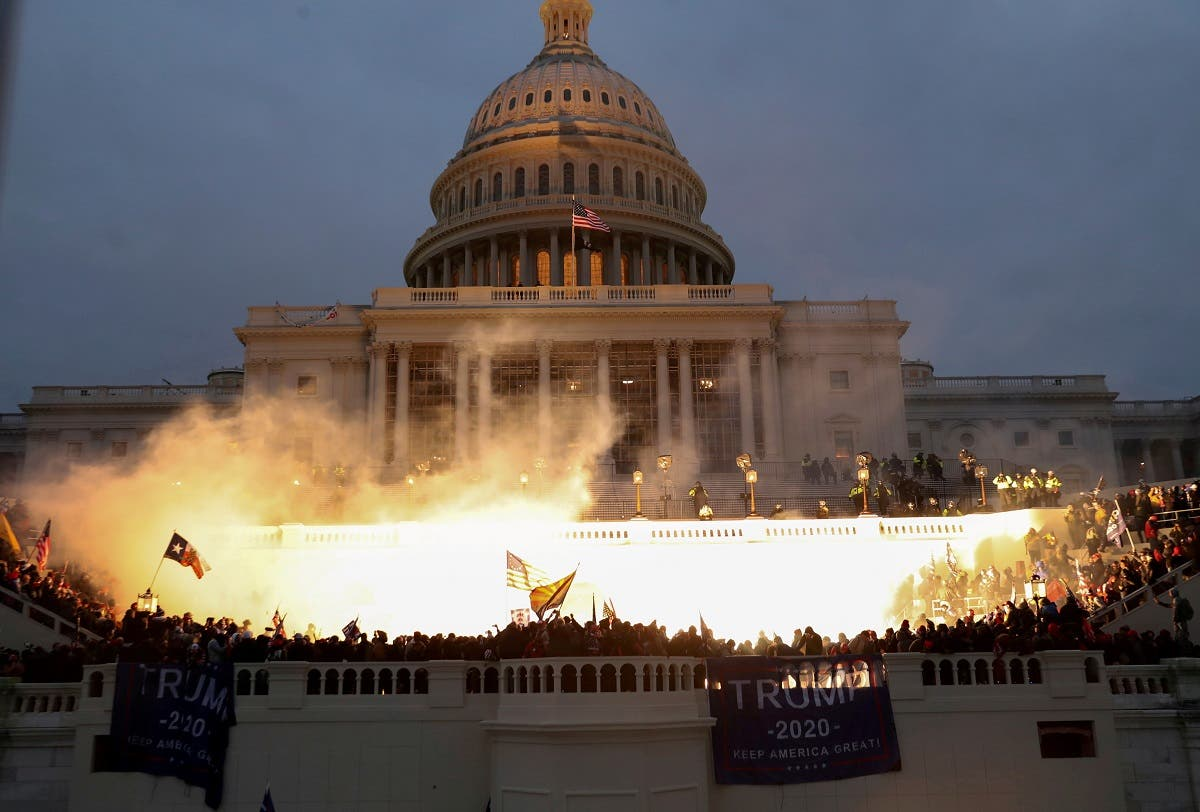 An explosion caused by a police munition is seen while supporters of U.S. President Donald Trump gather in front of the US Capitol Building in Washington, US, January 6, 2021. (Reuters)