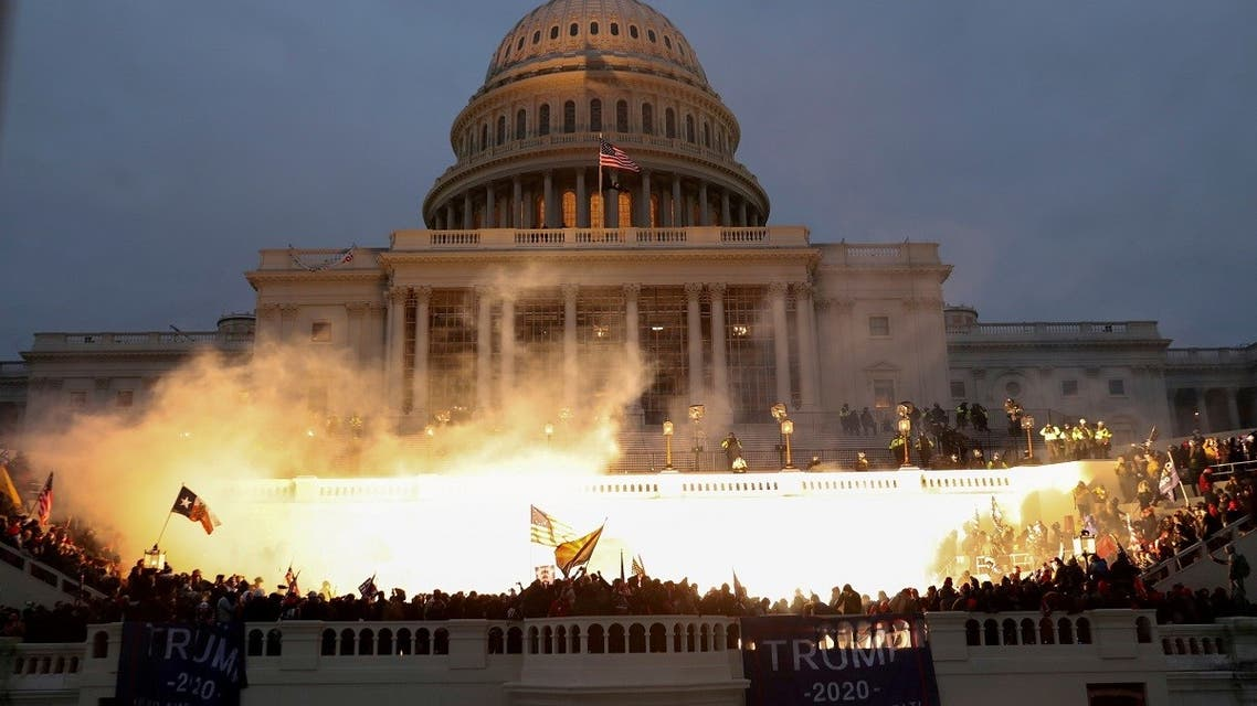 An explosion caused by a police munition is seen while supporters of U.S. President Donald Trump gather in front of the U.S. Capitol Building in Washington, U.S., January 6, 2021. REUTERS