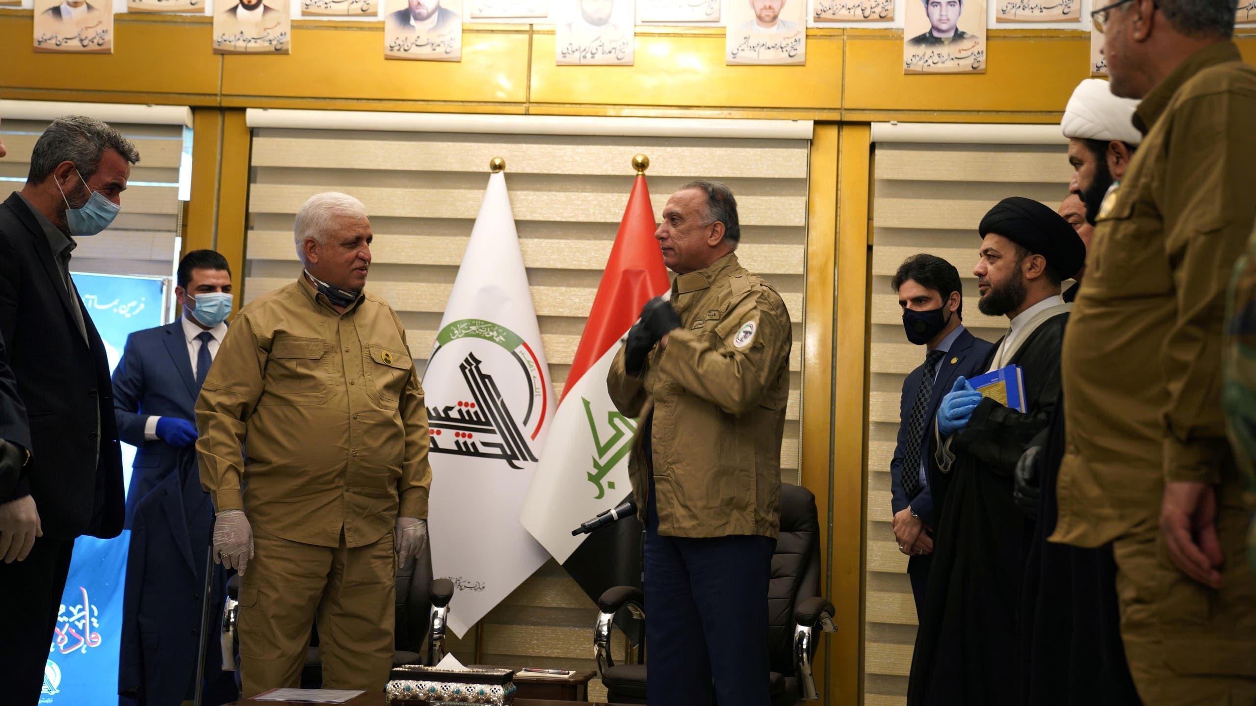 رئيس هيئة الحشد الشعبي فالح الفياض ورئيس الوزراء العراقي مصطفى الكاظمي (أرشيفية- رويترز)