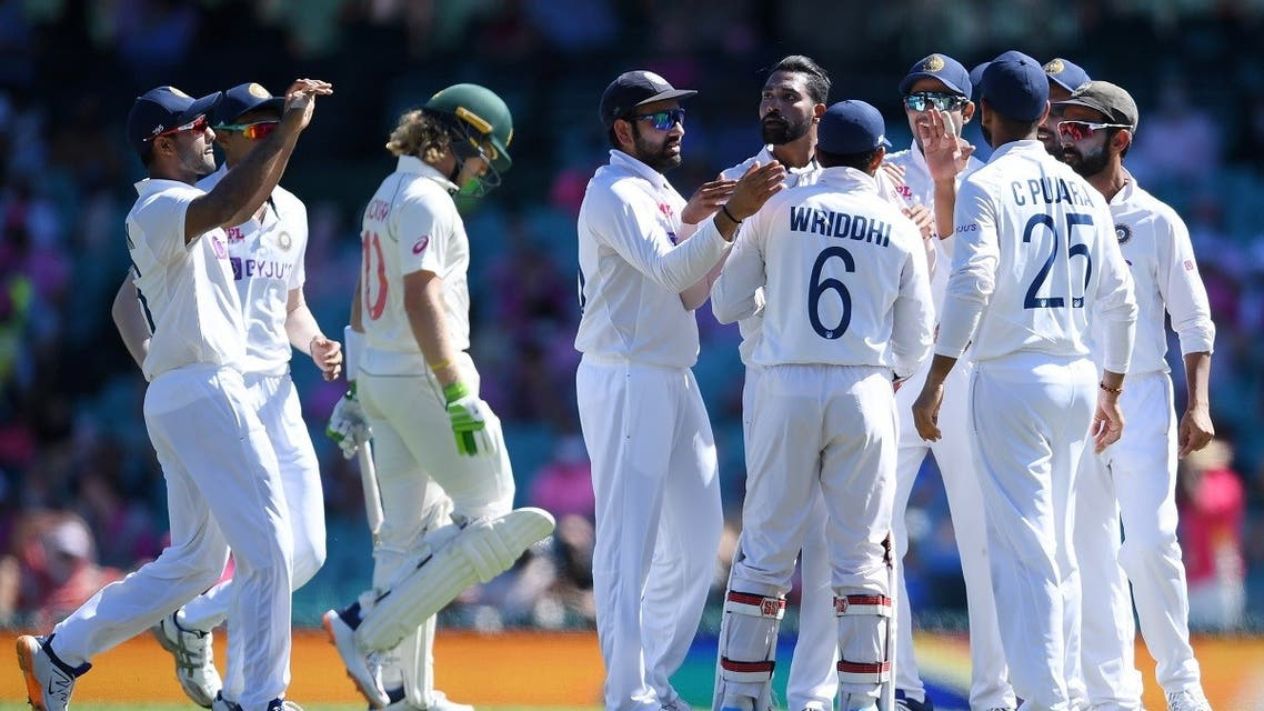 Indian players celebrate the wicket of Will Pucovski of Australia, caught behind off a Mohammed Siraj delivery for 10 during day three of the third test match between Australia and India. (Reuters)