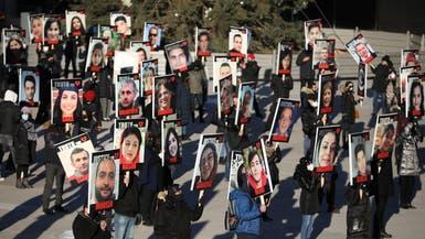 """رفعوا صور الضحايا.. كنديون يحيون الذكرى الأولى لـ """"الأوكرانية"""""""