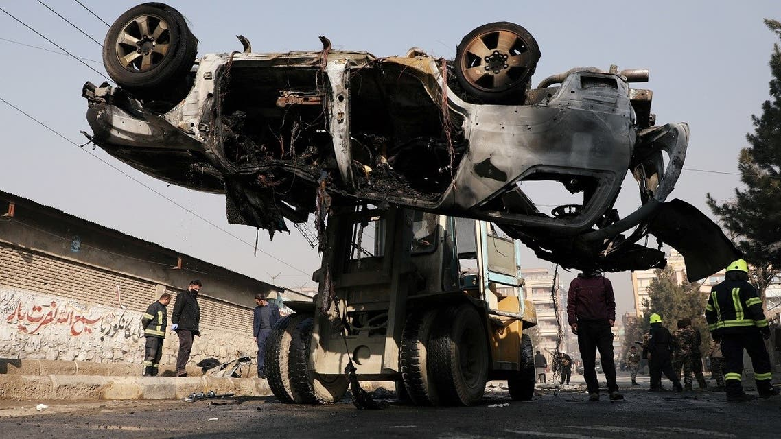 Afghan officials transport the wreckage of a burnt car at the site of a bomb blast in Kabul, Afghanistan January 10, 2021. (Reuters/Omar Sobhani)