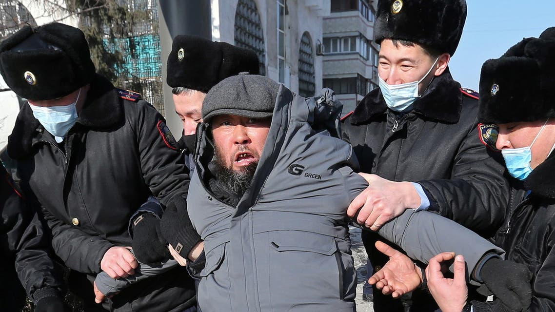 A protester is taken away by law enforcement officers during a rally held by opposition supporters on the parliamentary election day in Almaty, Kazakhstan January 10, 2021. REUTERS/Pavel Mikheyev