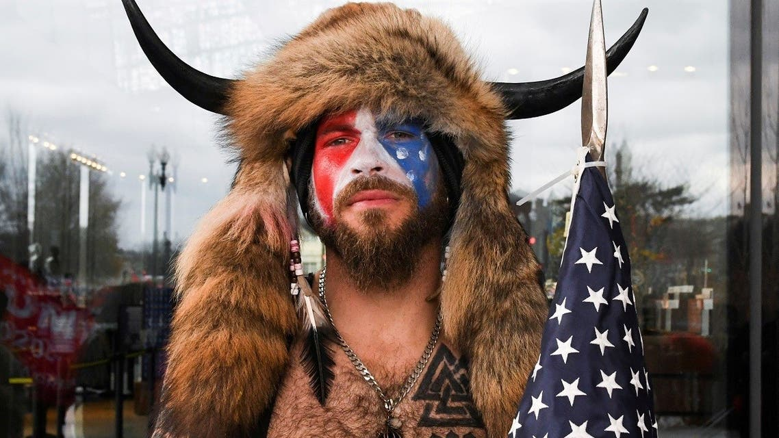 Jacob Anthony Chansley, also known as Jake Angeli, of Arizona, poses with his face painted in the colors of the US flag. (Reuters)