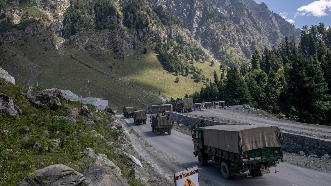 An Indian army convoy moves on the Srinagar- Ladakh highway at Gagangeer, northeast of Srinagar, Indian-controlled Kashmir. (AP)