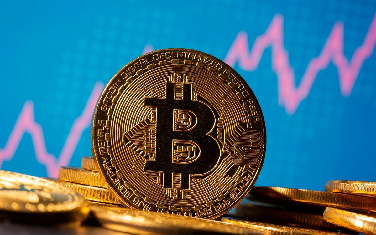 A representation of virtual currency Bitcoin is seen in front of a stock graph in this illustration taken November 19, 2020. (Reuters)