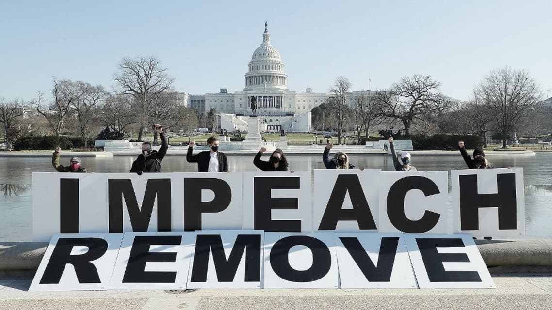 People gather at the base of the U.S. Capitol with large IMPEACH and REMOVE letters on January 12, 2021 in Washington, DC. (AFP)