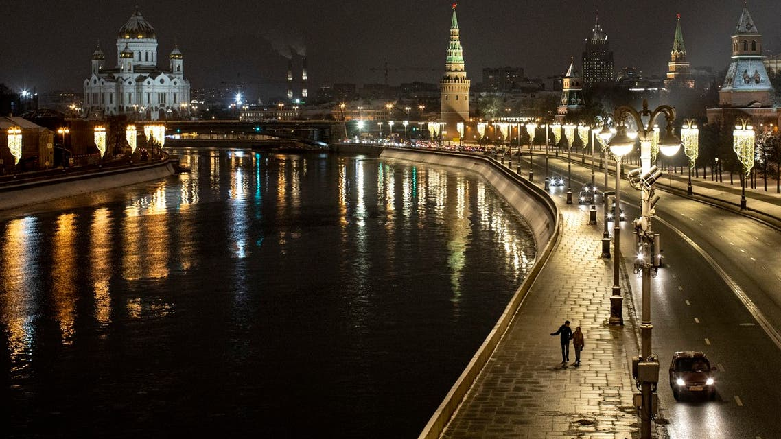 A couple walk an empty embankment of the Moscow River. (AP)