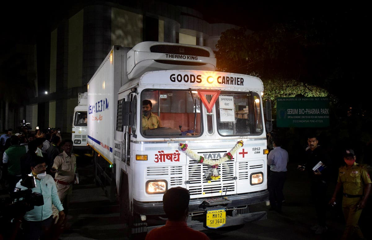 Trucks carrying first consignment of COVISHIELD, a coronavirus disease vaccine developed by AstraZeneca and Oxford University, leave from Serum Bio-Pharma Park of Serum Institute of India, for its distribution, in Pune, India, on January 12, 2021. (Reuters)