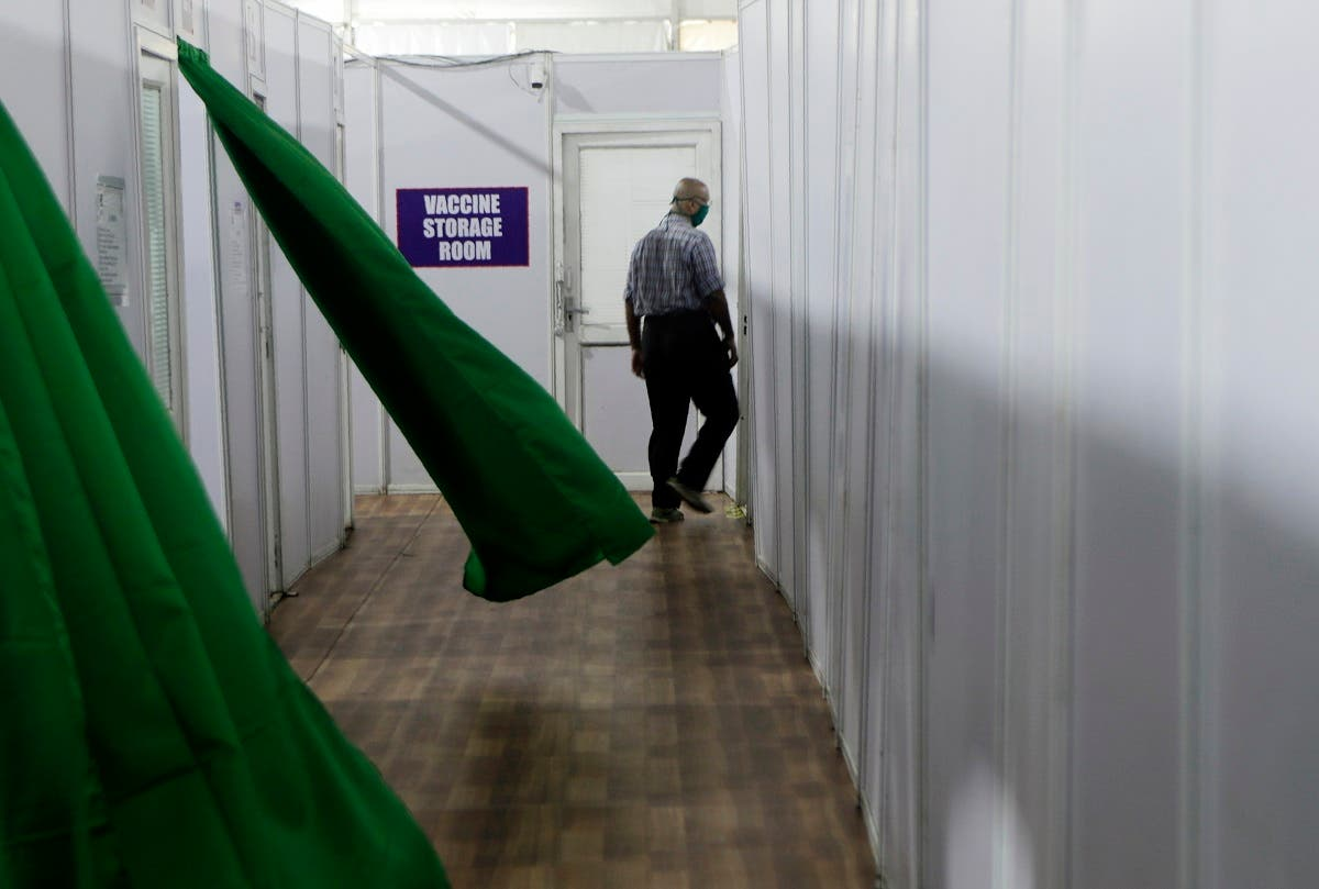 A health worker walks past a storage room during a trial run of COVID-19 vaccine delivery system, as India's prepare to kick off the coronavirus vaccination drive on January 16, 2021, in Mumbai, India. (AP)