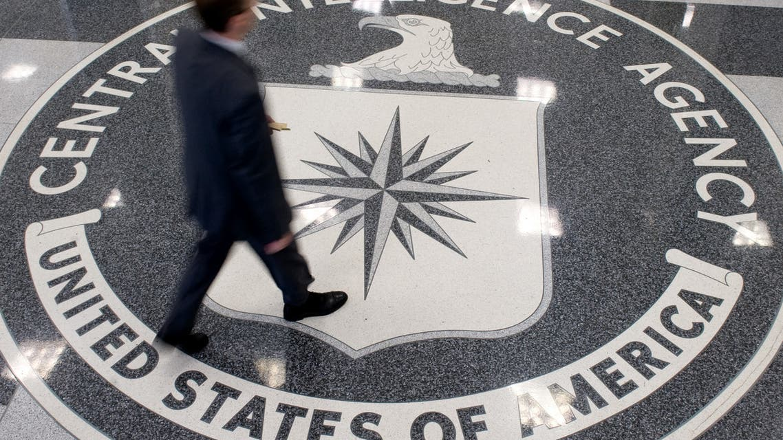 A man crosses the Central Intelligence Agency (CIA) seal in the lobby of CIA Headquarters in Langley, Virginia. (AFP)