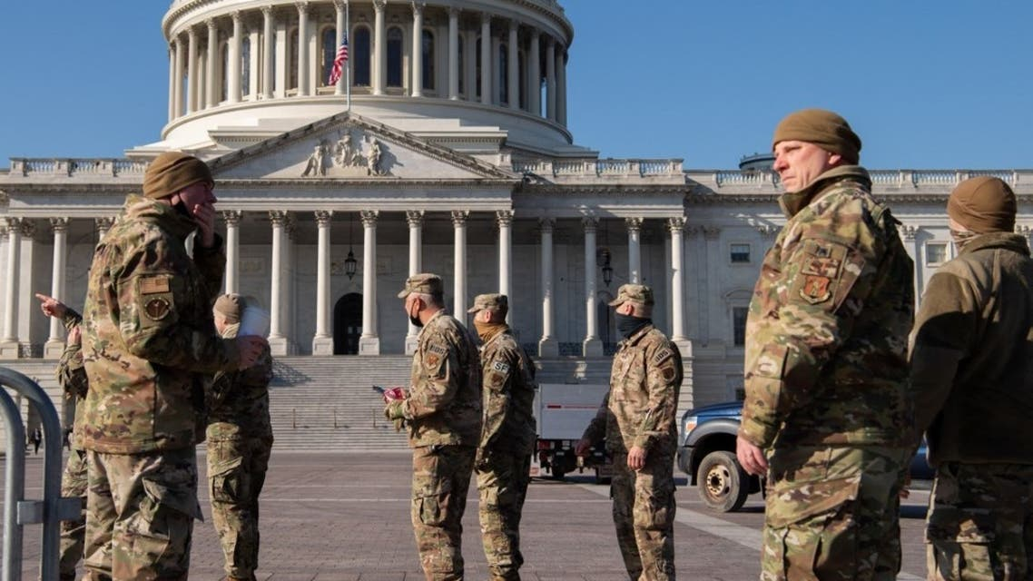 Members of the National Guard patrol outside of the US Capitol in Washington, DC, January 12, 2021. (AFP)