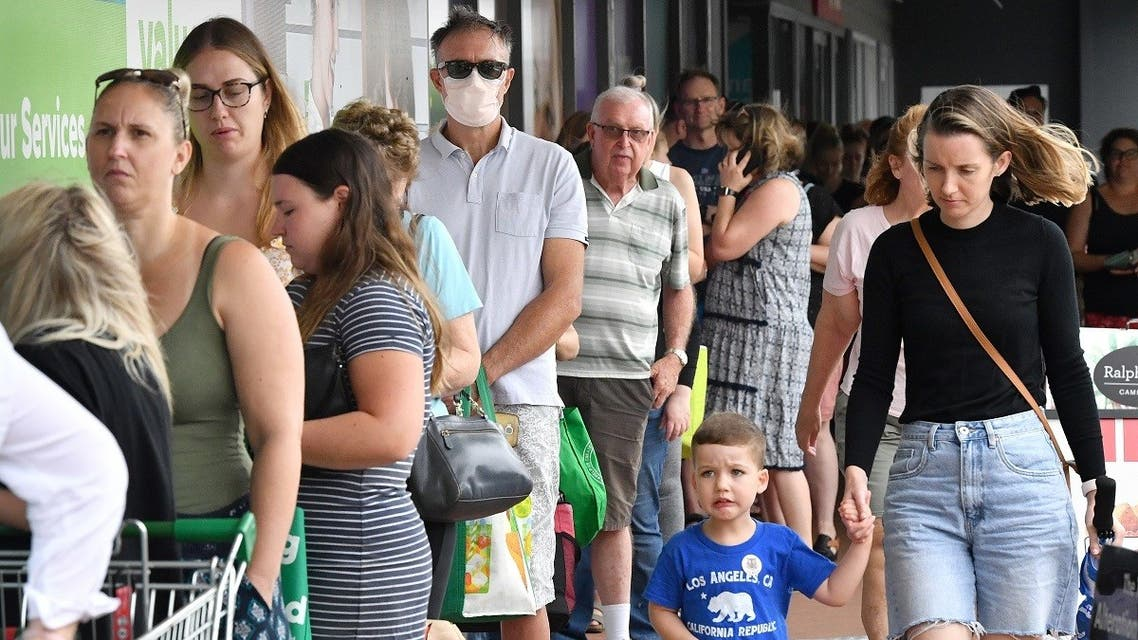 Shoppers queue to enter a grocery store before lockdown measures are imposed to curb the spread of the Coronavirus in Brisbane, the capital of the Australian state of Queensland, on Friday. (Reuters)