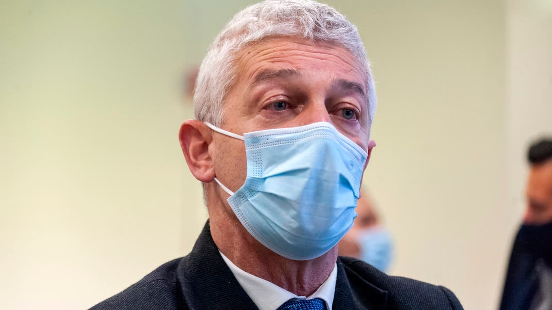 Prosecutor Nicola Morra wears a face mask to curb the spread of COVID-19 as he stands inside a specially constructed bunker hosting the first hearing of a maxi-trial against more than 300 defendants of the 'ndrangheta crime syndicate, near the Calabrian town of Lamezia Terme, southern Italy, Wednesday, Jan. 13, 2021. (AP)