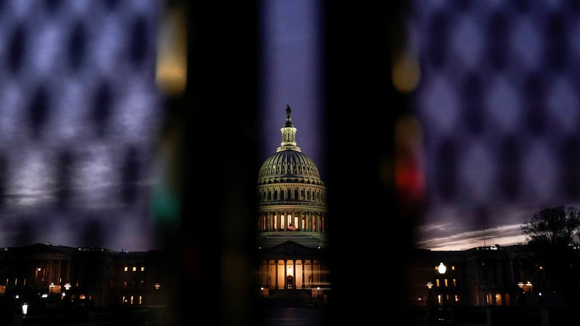 The U.S. Capitol is seen behind a security fence as Democratic lawmakers draw up an article of impeachment against U.S. President Donald Trump in Washington, U.S., January 11, 2021. (Reuters)