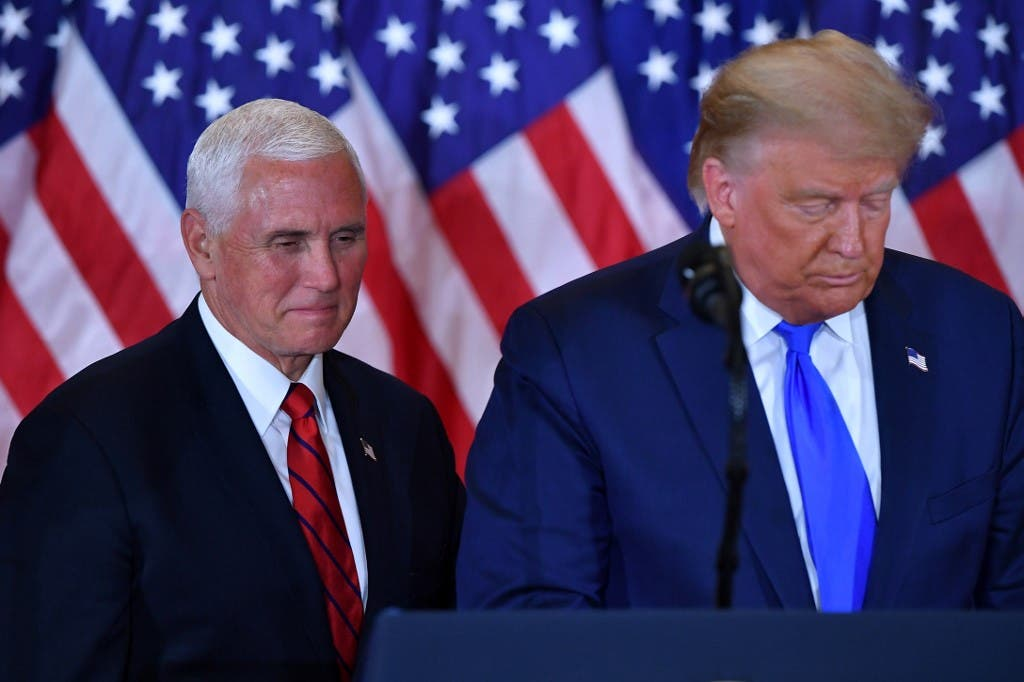 US President Donald Trump (R) and US Vice President Mike Pence (L) in the East Room of the White House in Washington, DC, early on November 4, 2020. (AFP)