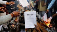 Indian farmers continue protests, burn new laws in show of defiance