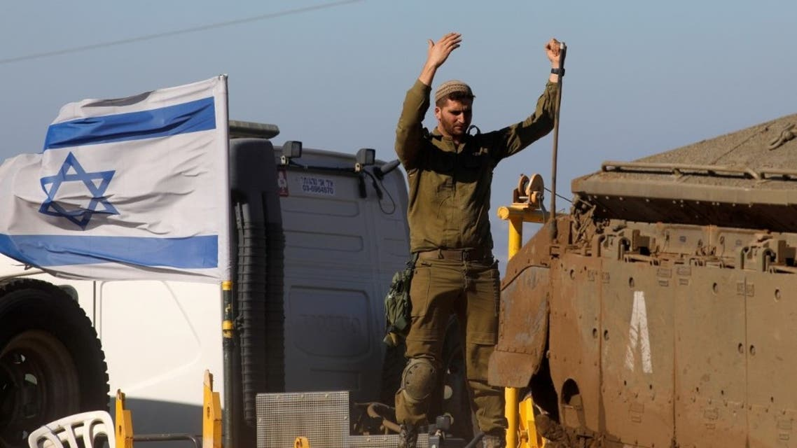 An Israeli soldier gestures as he stands atop an armoured personnel carrier during a military drill in the Israeli-annexed Golan Heights, on December 30, 2020. (AFP)