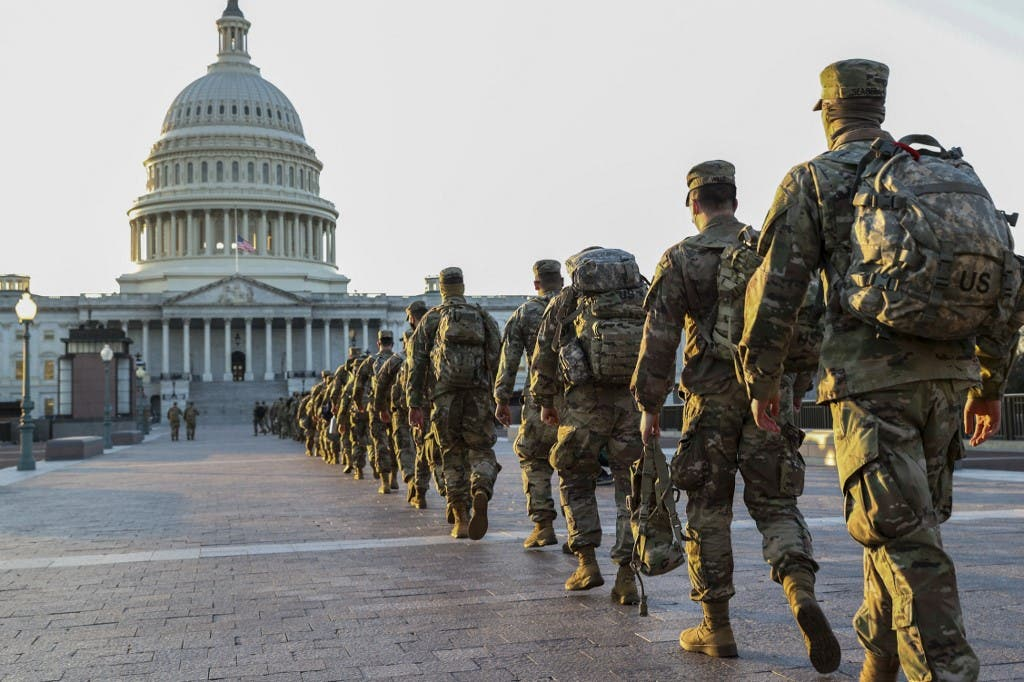 Members of the US National Guard arrive at the US Capitol on January 12, 2021 in Washington, DC. (AFP)