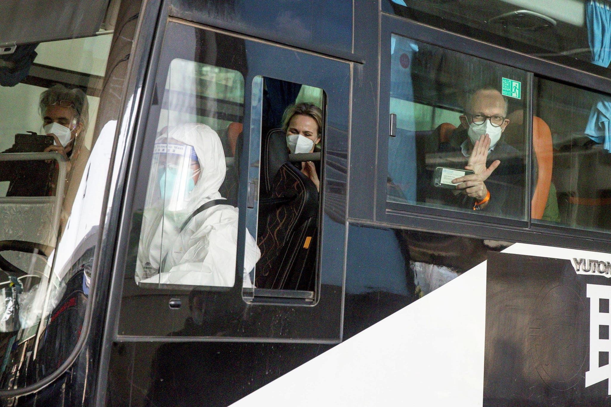 WHO team sit on a bus while leaving Wuhan Tianhe International Airport in Wuhan, Hubei province, China. (Reuters)