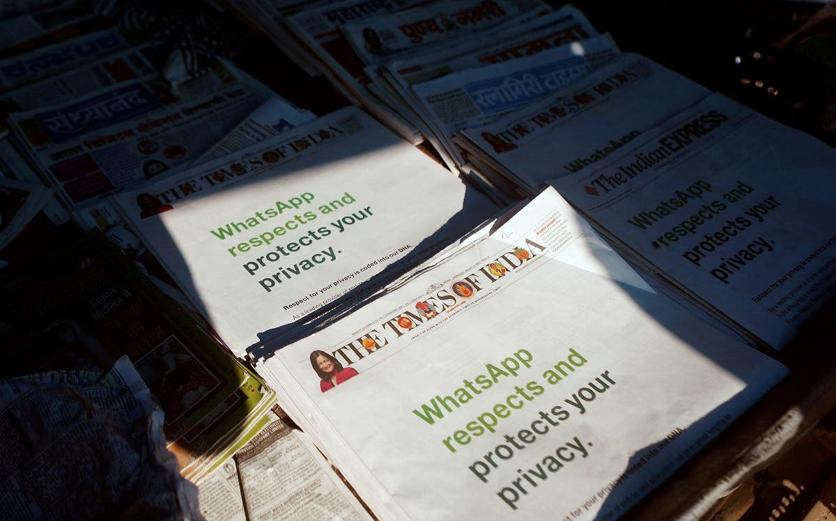 A WhatsApp advertisement is seen on the front pages of newspapers at a stall in Mumbai. (Reuters)