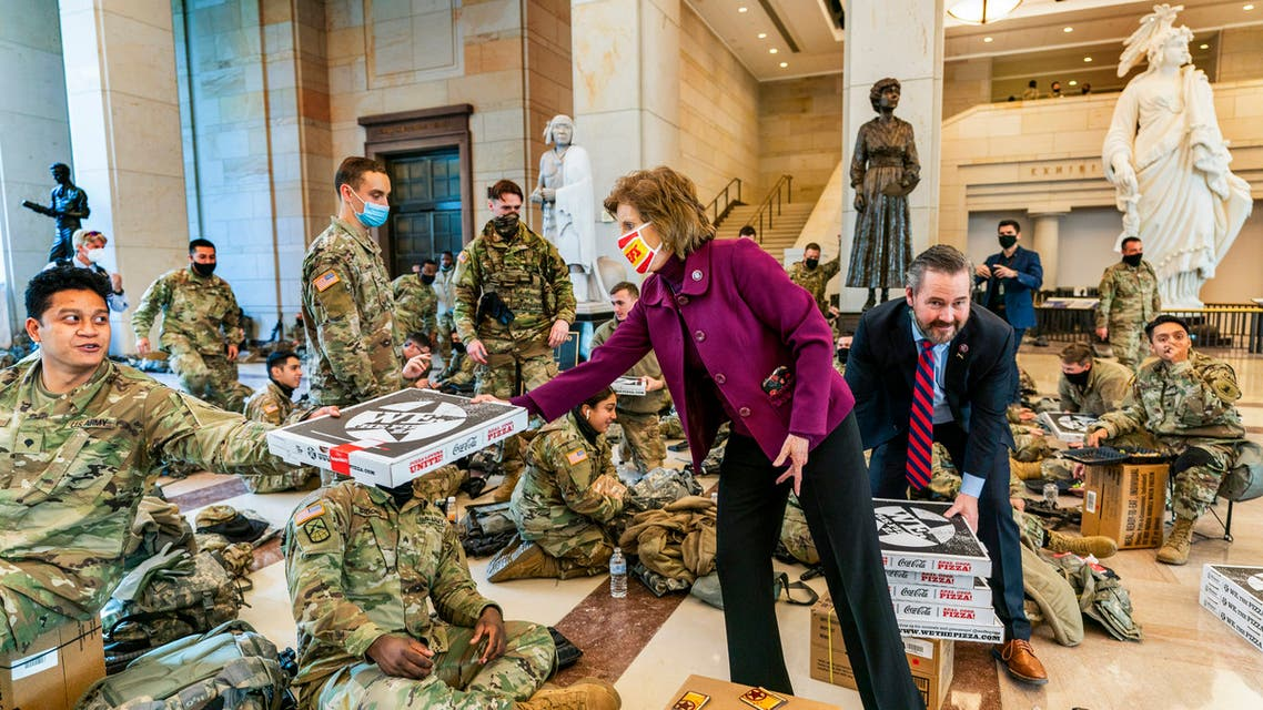 Rep. Vicky Hartzler, R-Mo., and Rep. Michael Waltz, R-Fla., hand pizzas to members of the National Guard gathered at the Capitol Visitor Center, Wednesday, Jan. 13, 2021, in Washington. as the House of Representatives continues with its fast-moving House vote to impeach President Donald Trump.  (AP)