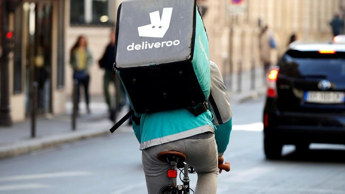 A cyclist rides a bicyle as he delivers food for Deliveroo, an example of the emergence of what is known as the 'gig economy', in Paris. (Reuters)