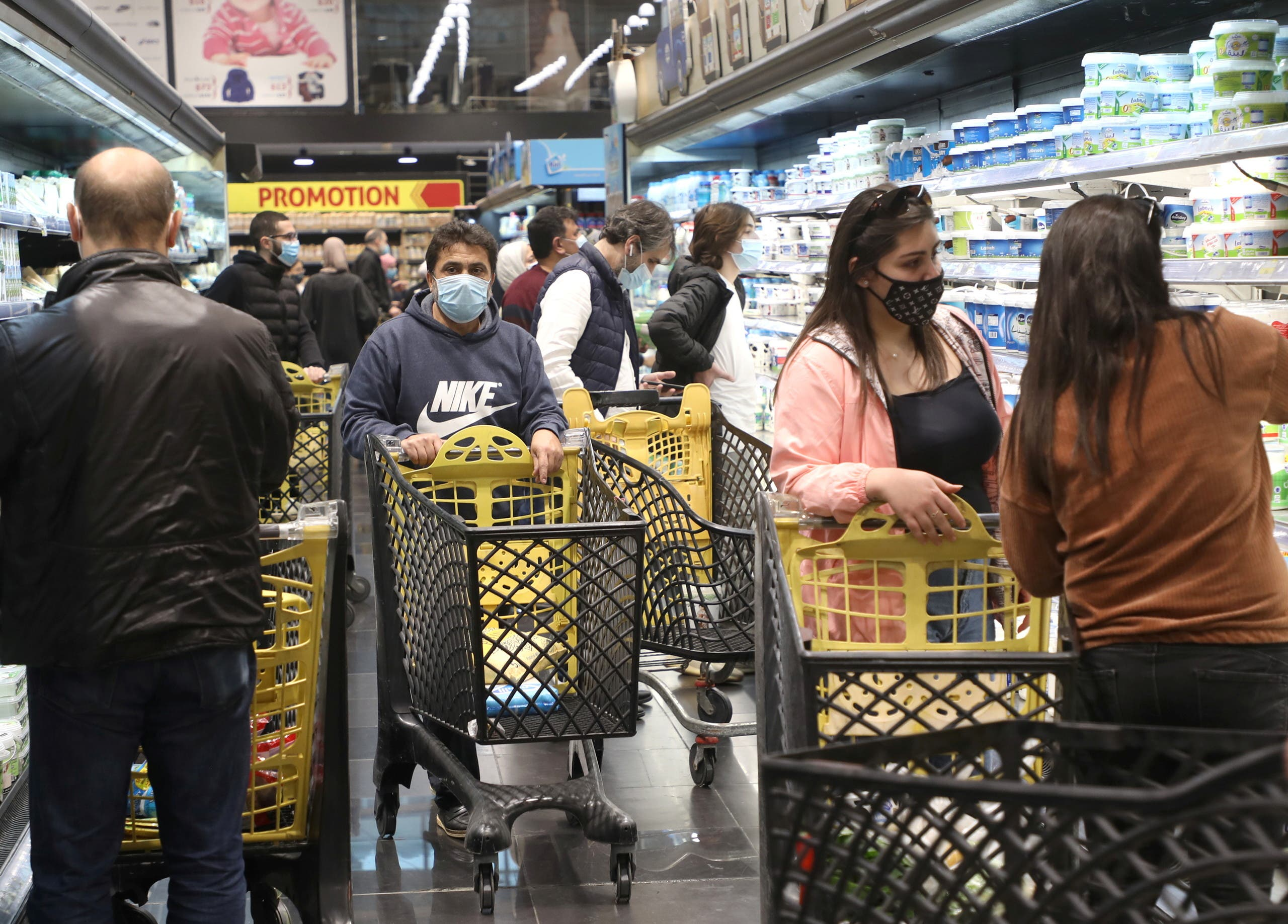 People shop at a supermarket ahead of a tightened lockdown and a 24-hour curfew to curb the spread the coronavirus disease (COVID-19) outbreak in Beirut. (Reuters)