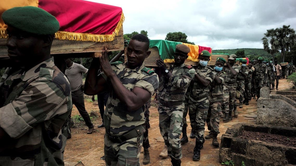 File photo of soldiers carrying flag-draped coffins of the 10 comrades, that the army said were killed in militant attacks in Gueri town, during an honor ceremony at the army headquarters in Kati, Mali, on September 6, 2020. (Reuters)