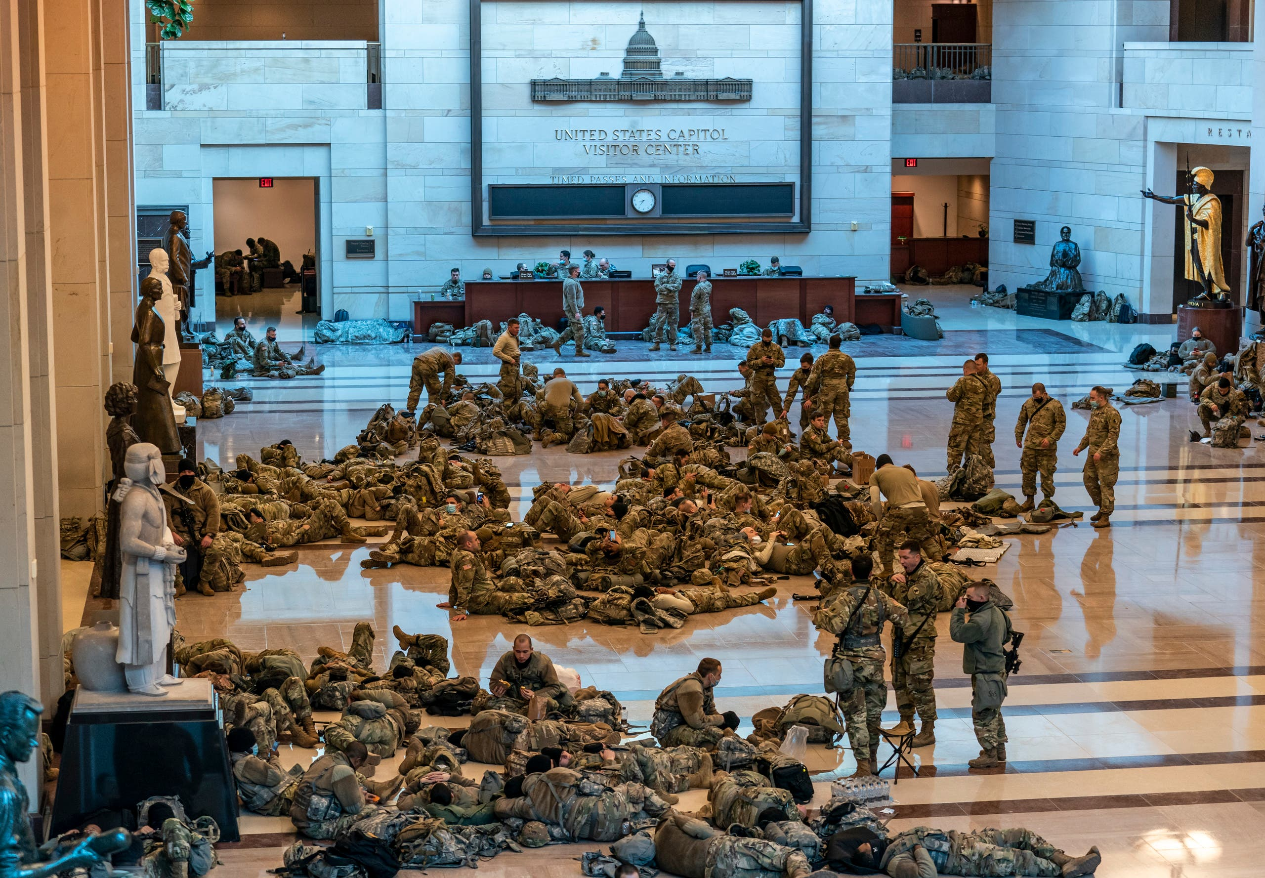 Hundreds of National Guard troops hold inside the Capitol Visitor's Center to reinforce security at the Capitol in Washington, Wednesday, Jan. 13, 2021. The House of Representatives is pursuing an article of impeachment against President Donald Trump. (AP)