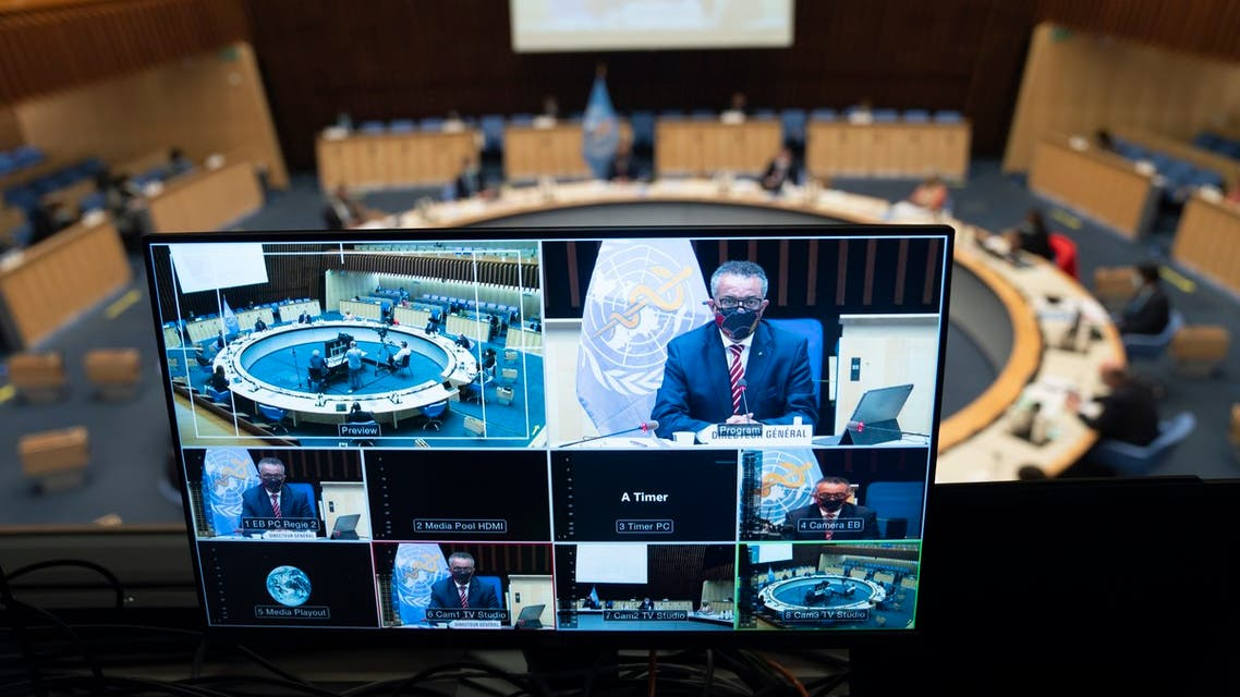 This handout picture taken and released by the World Health Organization on October 5, 2020 shows World Health Organization (WHO) Director-General Tedros Adhanom Ghebreyesus wearing a protective face mask delivering a speech on a TV screen during a WHO executive board special session on the Covid-19 response at the health agency's headquarters in Geneva. The WHO estimated Monday that 10 percent of the world has been infected by the new coronavirus -- way more than has been recorded -- as it mulled speeding up internal reforms.