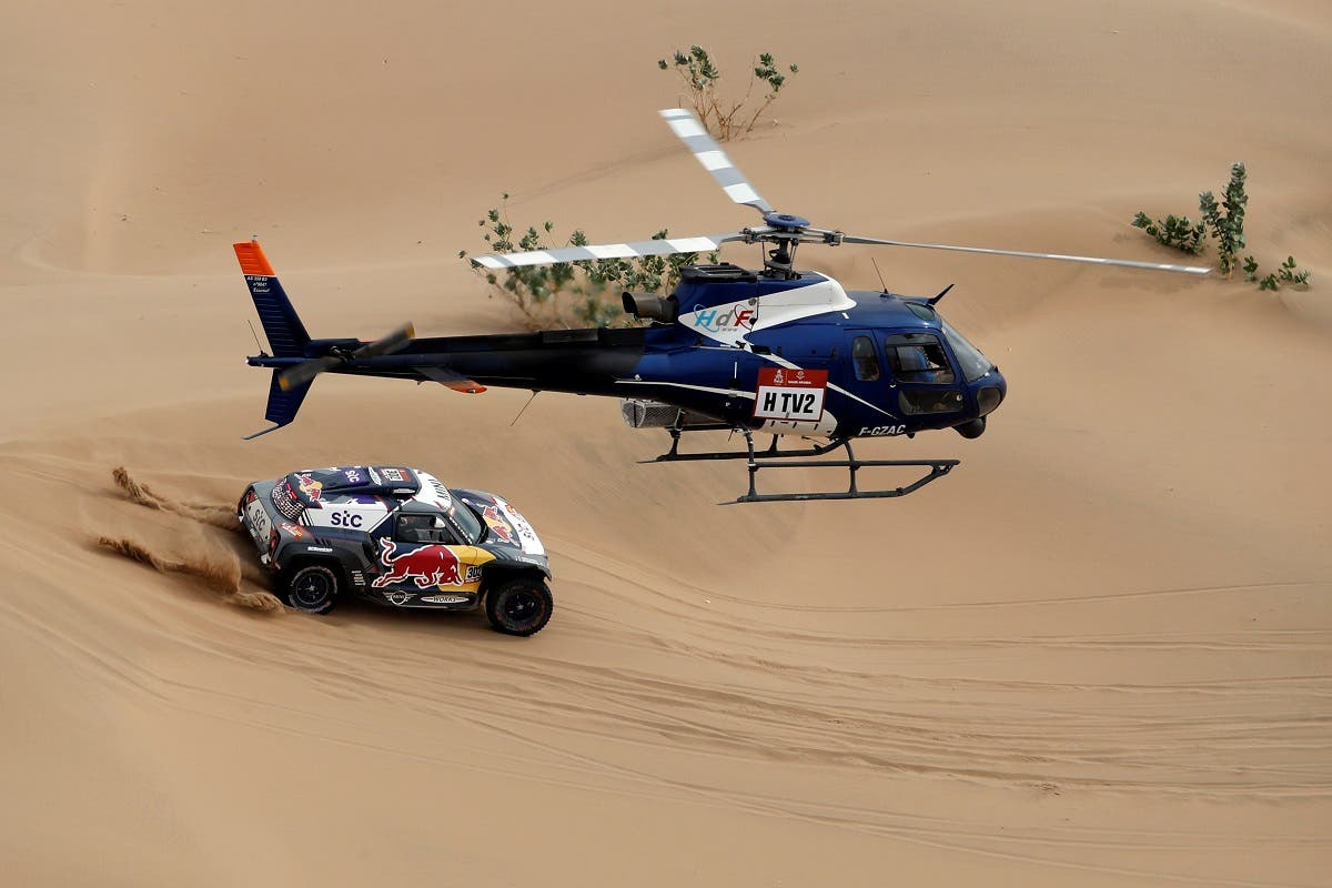 X-Raid Mini JCW Team's Stephane Peterhansel and Co-Driver Edouard Boulanger in action during stage 11. (Reuters)